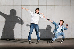 Two rollers having fun (alexey05) Tags: boy two sky urban man male guy boyfriend smile sport standing fun happy person clothing cool friend adult outdoor skating young roller