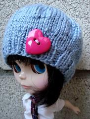 Ker isn't sure she likes the hat