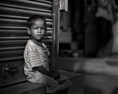 Why me ? (RAJAT SUBHRA) Tags: india black monochrome children faces great incredible kolkata bengal calcutta bangla bengali westbengal bengalbangla shudhuibangla artofimages incrediblebengal facesincrediblebengal kolkatawestbengal