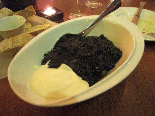 Black rice with cuttlefish, prawns and alioli