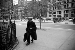 The Artist (The Round Peg) Tags: people blackandwhite usa ny newyork man hat america walking others manhattan cigarette smoke streetphotography objects places things artists madisonsquarepark actions clothings 2875mm stockcategories