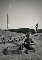 Mud Shapers [Future] (AvikBangalee) Tags: chimney blackandwhite bw kid nikon mud earth labor crying soil barefoot worker dhaka dslr tamron 18200 bangladesh bnw motherandchild digitalphotography d90 brickkiln keraniganj