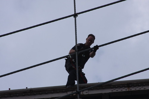 NYPD pursues jumper up the cable to the tower