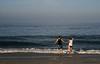 Aaron and Liz. (AIM to the E Photography) Tags: blue sky beach sand couple sandiego holdinghands amyhenderson canondigitalrebelxti february09