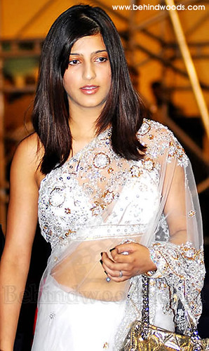 Shruti Haasan in stunning hairstyle and white sari