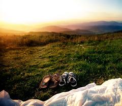 sunrise (colerise) Tags: light sky mountains texture nature field sunrise landscape shoes picnic sandals horizon hill snapshot perspective dramatic surface blanket smokey