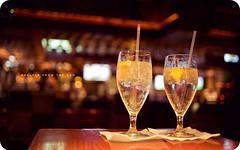 Shelter from the Sun (isayx3) Tags: sun sports water glass bar 35mm cafe nikon dof bottles bokeh lemons drinks napkins f2 365 resturant nikkor shelter d3 strays refreshements plainjoe isayx3