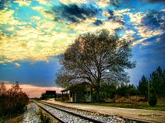 old train station (Knock out (back again...and again)) Tags: sunset sky tree colors station clouds train greece macedonia rails serres alistrati