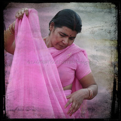 The Navy Blue of India (designldg) Tags: pink portrait people woman india heritage water fashion rose river square photography hands colours humanity expression embroidery silk culture atmosphere grace panasonic human fabric soul ethereal varanasi tradition shanti hindu hinduism saree kashi sari breastcancer ganga pinkribbon breastcancerawarenessmonth ganges ghats benaras garment femininity uttarpradesh  corporeal pinkforoctober indiasong dmcfz18