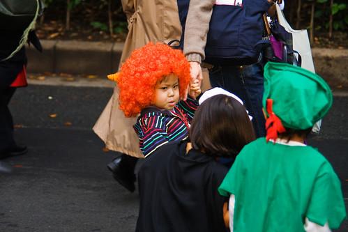 Scowling clown, Tokyo, Halloween by Buz Carter.