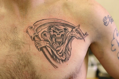 Grim reaper tattoo on chest