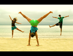 Prancing & Dancing (Hueystar) Tags: ocean sea beach jumping sand tricks cartwheel headspin