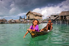 Omadal, Semporna - The young Sea Gypsies and their Floating Village (Mio Cade) Tags: boy sea girl children boat kid village sweet adorable malaysia float gypsy sabah semporna bajau omadal