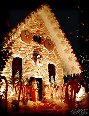 A Towering Gingerbread House (Marcie Gonzalez) Tags: california santa county christmas houses light red orange house holiday building beach water cookies yellow cane club night canon festive bread photography gold lights golden bay ginger holidays cookie baker santas waterfront candy decmeber gingerbread large front structure resort sugar southern newport sweets destination casual tall gonzalez candycane balboa oc resorts festivities bake marcie frosting baked pastery elegance bayfront the balboabayclubandresort thebalboabayclubresort marciegonzalez marciegonzalezphotography
