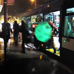 Paris by Night (philoufr) Tags: motion blur paris reflection bus green night umbrella square vert reflet nuit flou mouvement ratp parapluie ruedamsterdam carrfranais canonpowershots90