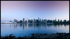 Across the calm waters of Coal Harbour (Eric Flexyourhead) Tags: sunset urban canada water skyline vancouver reflections evening downtown bc britishcolumbia burrardinlet stanleypark ripples canadaplace coalharbour zd olympuse3 918mm