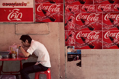 Food Culture (Ioannis P. Skaltsas) Tags: street city travel red portrait urban food man texture wall thailand asia eating bangkok candid posters cocacola indochina krungthep ioannispskaltsas