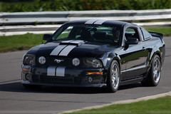 Black S197 Roush Mustang (lclutchl) Tags: 2005 wallpaper motion black silver moving action michigan background stripes 2006 racing hills mustang panning 2008 2009 coupe waterford 2007 raceway clarkston scca roush s197