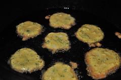 Indian Potato Pancakes (mooshrimp) Tags: food yellow dinner yummy nikon indian tasty bubbles delicious crispy potato oil pan appetizer pancake fried batter potatopancakes d5000