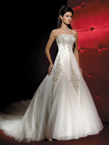 Strapless gown with embroidery and sequins.