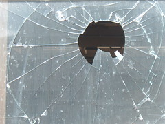 hole in shattered glass pane
