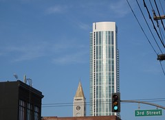 San Francisco: Schmidt Lithography Tower & One Rincon Hill (Anomalous_A) Tags: sanfrancisco california sky tower clock architecture buildings landmark clocktower blimp airship soma southofmarket dirigible rincon onerinconhill maxschmidtlithographcompany schmidtlithographytower