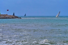 Sharks! (Fnikos) Tags: sea seascape water boat sailboat waterfront coast rock rocks people wave waves sky skyline outdoor