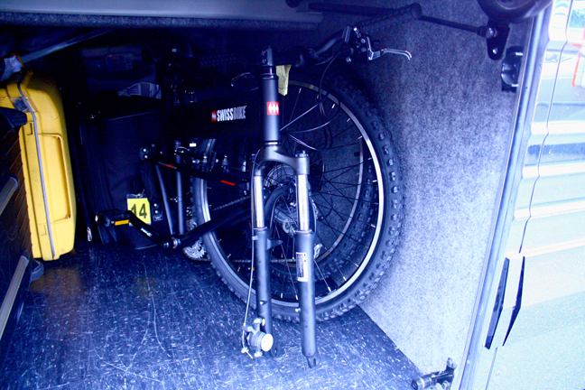 The new Montague Swissbike LX folds up and fits comfortably underneath the tour bus along with the other luggage.