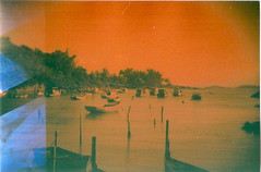 Boats (jasminfish) Tags: bridge brazil cats colors brasil boats island lomo lomography barcos mask ponte es ilha wrecked mscara vilavelha colorido lomografia gambiarra 3ponte experincia morrodomoreno redscale fujisuperiaiso100 praiadoribeiro muitascores holga135bc