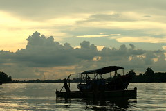 Sunset @ Mekong (Rainedom) Tags: sunset sky people colors fruits animals canon children fun boat coconut rich culture vietnam swamp rides hcmc mekongriver vungtao 400d rainedom rainescape