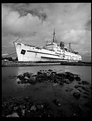 Duke of Lancaster 1 (a northernman) Tags: sea boat rust empty cruiseship rodinal derelict 45mm cruiseliner fujiacros ghostship pentax67 dukeoflancaster maryceleste leftinport
