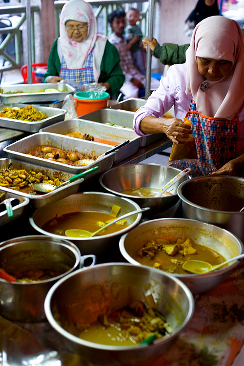 Serving up Muslim-style Thai dishes at a post-fasting food market, Pattani