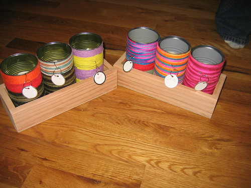 The yarn cans in their wooden holders