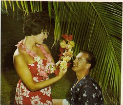 Getting Lei-ed On Hayman Island, Qld (glen.h) Tags: travel flowers men tourism women 60s queensland 1960s tropics sixties haymanisland thenorthqueenslandannual
