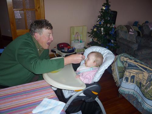 Grandpa feeding Nora