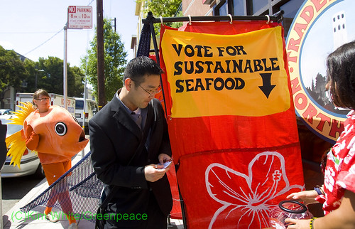 Greenpeace activists with customer in front of Trader Joe's for a Traitor Joe's protest