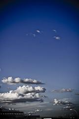 Nubes y claros... (InVa10) Tags: blue windows sky españa white building blanco azul clouds canon eos lights spain edificio badajoz ventanas cielo nubes farolas 450 extremadura claros inva 450d