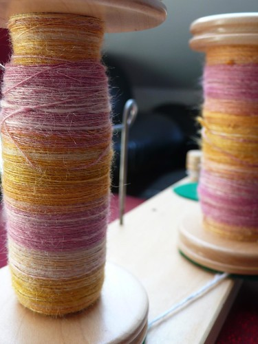 Two bobbins of silk singles