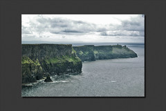 The Cliffs of Moher. Ireland.- (ancama_99(toni)) Tags: ocean county trip travel blue ireland light sea vacation sky irish cliff paisajes naturaleza holiday color green beach nature water azul clouds marina photoshop landscape geotagged photography coast mar photo agua nikon europa europe clare waves photos doolin photographic irland eire cliffs atlantic layers cliffsofmoher paysage paesaggi olas atlanticocean 2009 emeraldisle aigua moher attraction atlntico irlanda paisagens irlande oceano marinas atlantico countyclare ocano d60 acantilados eireann republicofireland cliffofmoher 10faves landschaftsaufnahmen ancama99 7naturalwonders saariysqualitypictures atomicaward new7naturalwonders