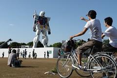 Boys coming to Odaiba by their bicycles (rhythmsift) Tags: park bicycle japan tokyo sony cybershot odaiba gundam deconstruction dscr1 shiokaze