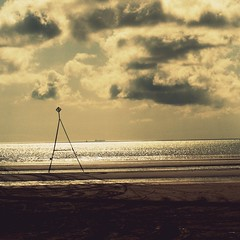 they'll never, never, never take the summer from me (JessicaRose:)) Tags: sea england sky beach water sign clouds crossprocessed sand yorkshire north tracks east posts bridlington