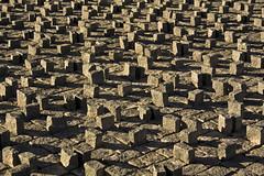 Tiny Tombs (Rubn Daz Alonso) Tags: lighting light shadow luz stone canon shadows floor stones sombra sombras iluminacion piedras suelo piedra