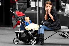 Setting a good example (Bob the Binman) Tags: baby girl mobile female nikon phone boots stroller mother smoking jeans mum attractive denim brunette smoker buggy middlesex staines d90