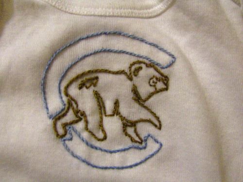 Close up of Cubs onesie