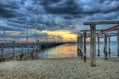Kerford Rd pier (J-C-M) Tags: sunset reflection water clouds photoshop pier nikon bracket d70s melbourne hdr albertpark topaz 3xp photomatix tonemapped