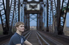 Portrait (Billy Wilson Photography) Tags: bridge portrait selfportrait ontario canada digital canon eos rebel 50mm tracks railway structure xs f18 soo northern saultstemarie northernontario algoma railwaytracks billywilson