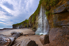 seasonal (tropicaLiving - Jessy Eykendorp) Tags: sky bali seascape beach nature water clouds canon season indonesia landscape island photography eos lights daylight waterfall rocks outdoor seasonal usm volcanic efs 1022mm tanahlot f3545 50d melasti