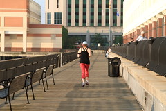 (pmarella) Tags: city morning urban usa color building girl fence bench newjersey jerseycity shadows candid nj whatever viewlarge pmarella hudsonriver donttrythisathome hudsoncounty amomentintime anotherdayinparadise joging throughmyglasseye riverviewpkproductions icoverthewaterfront myeyeshaveseenthis eos7d exchangepljerseycity