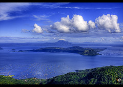 The Taal Volcano Viewed From Tagaytay [1] ([ Rodelicious ]) Tags: trip travel blue light vacation sky sun color colour art beach nature beautiful beauty smile clouds contrast photoshop canon landscape geotagged photography volcano photo interestingness exposure dof photos philippines explore pk tagaytay taal canoneos hdr highdynamicrange hdri blending waterscape rodel mabuhay photomatix tonemap colorphotoaward aplusphoto pinoykodakero canon40d colourartaward perfectescapes rodelicious ifolio garbongbisaya rodeljoselitomanabat gettyimagesphilippinesq1 gettyimagesasia gettyimagesphilippines