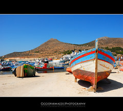 Favignana - A colorful boat at the harbour (ciccioetneo) Tags: trip sea sun beautiful fun nikon perfect holidays mare photographer enjoy sicily d200 sole sicilia vacanze trapani favignana the divertimento nikond200 isoleegadi egadiislands cicciofarmaco